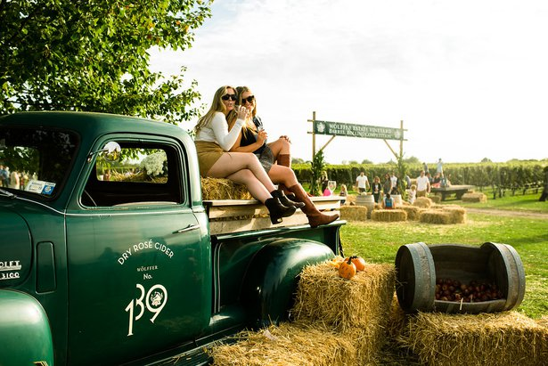 girls on cider truck at harvest party