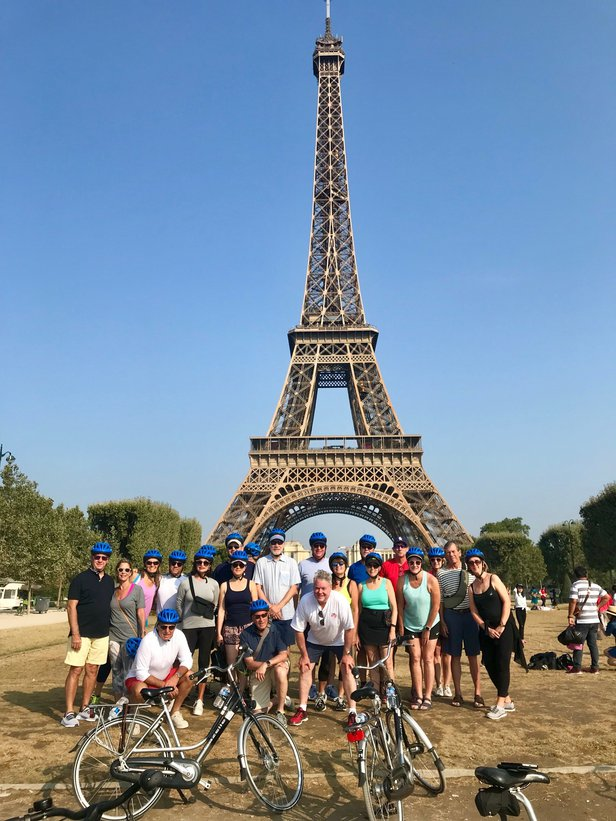 roman and tour group in front of eiffel tower